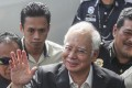 The embattled 64-year-old Najib Razak appeared relaxed, smiling and waving as he walked through a throng of journalists. Photo: EPA
