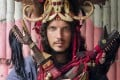 Marco Ferrarese wears a Minahasa warrior headdress in north Sulawesi, in Indonesia. Picture: Kit Yeng Chan