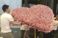 A Chinese man arranged to have a bouquet, worth more than US$50,000, made out of 100-yuan banknotes for his girlfriend's birthday. Photo: News.163.com