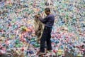 China has outlined new measures to improve the way it recycles and disposes of solid waste, like bricks and concrete, and prevent illegal dumping, in a bid to tackle one of its major pollution problems. Photo: AFP