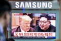 South Koreans watch a television screen broadcasting a news report featuring images of Donald Trump and Kim Jong-un at a subway station in Seoul on May 25 after Trump announced the cancellation of the summit between the two leaders. Photo: Bloomberg