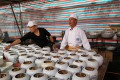 Chef Lin Ming-tsan supervises the plating of a soup known as Buddha Jumps Over the Wall ahead of a bando at Taipei's Shilin Night Market, in December. Pictures: Katy Hui-wen Hung