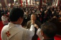 A man receives Holy Communion during an Easter Sunday mass at the state-controlled Xishiku church in Beijing. The detained Japanese may have been targeted in a crackdown on missionary work. Photo: Reuters