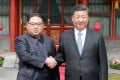 North Korea's leader, Kim Jong-un, shakes hands with Chinese President Xi Jinping in March. A high-ranking North Korean official was reportedly in Beijing on Thursday after US President Donald Trump scrapped his planned summit with Kim. Photo: AFP/KCNA via KNS