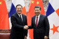 Panama President Juan Carlos Varela (left) shakes hands with Chinese President Xi Jinping during his visit to Beijing in November. Photo: Reuters