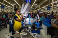 """An employee scans a customer's purchases at a Walmart. An alliance of rights groups has released a report claiming that women who work in Asian factories making clothes for the global retail giant are at """"daily risk"""" of slapping, sexual abuse and other harassment. Photo: Bloomberg"""