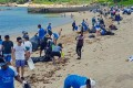 Volunteers taking part in a clean-up of Lamma Island's Sham Wan, or Turtle Beach, on Sunday. Photo: Facebook