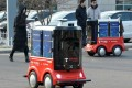 In January JD.com demonstrated these driverless delivery vehicles in the northern Chinese city of Tianjin. It is now moving to introduce unmanned trucks to improve efficiency in logistics operations. Photo: AFP