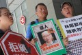 Members of The Federation of Bus Industry Trade Unions protest outside the independent review committee meeting in Tamar. Photo: KY Cheng