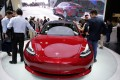 A Tesla Model 3 car is displayed during a media preview at the Auto China 2018 motor show in Beijing in April this year. The world's fleet of electric vehicles is likely to more than triple to 13 million by the end of this decade, up from 3.7 million units last year, according to the International Energy Agency. Photo: Reuters