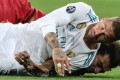 Mohamed Salah is injured after a challenge by Sergio Ramos (front) during the Champions League final. Photo: EPA