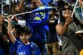 A young supporters of Rajasthan Royals celebrates winning an Indian Premier League (IPL) Twenty20 match. Photo: AFP