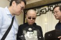 Liu Xia, the wife of Liu Xiaobo, holds a portrait of her husband at his funeral last year. She remains under de facto house arrest. Photo: AP
