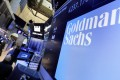 A logo for Goldman Sachs appears above a trading post on the floor of the New York Stock Exchange in 2016. Photo: AP