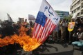 Iranians burn US flags during an anti-US protest after weekly Friday prayer ceremony in Tehran on 11 May 2018. Iranians gathered to protest against the US and President Donald Trump after withdrawing from a 2015 nuclear deal. Trump on 08 May 2018 announced that US will withdraw from the nuclear deal. Foreign ministers from six world powers and Iran finally achieved an agreement to prevent the Islamic republic from developing nuclear weapons, Western diplomats said in Vienna on 14 July 2015. Photo: EPA-EFE/STRINGER