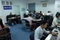 Fresh News staff work in their newsroom in Phnom Penh. Photo: AFP