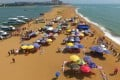 Tourists catch some rays on Yudai Beach in Boao in Hainan. Photo: Xinhua