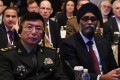 Chinese Lieutenant General He Lei (left) and Canadian defence minister Hajit Sajjan attend the first plenary session of the Shangri-La Dialogue on Saturday. Photo: AFP