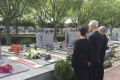 Chu Yiu-ming (middle) and Ah Hung (right) pay their respects at the grave of Jean-Ortiz. Photo: Reverend Chu Yiu-ming