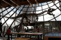 A 150-million-year-old dinosaur skeleton, which is 70 per cent intact, was bought at an auction at the Eiffel Tower in Paris on Monday. Photo: Reuters