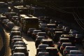 Traffic in Beijing. Two thousand taxis running on swappable batteries are currently servicing the city's suburbs. Photo: AFP