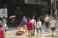 Jaywalkers at the junction of Queen's Road Central and Wyndham Street in Hong Kong on a recent hot day in May. Photo: Stuart Heaver