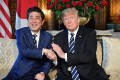 US President Donald Trump greets Japanese Prime Minister Shinzo Abe at their last meeting in May. Abe is again headed to Washington to try to make sure Trump does not overlook Japan's security and diplomatic concerns at next week's US-North Korea summit in Singapore. Photo: AFP