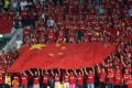 Chinese fans hold their national flag before the start of the Fifa World Cup 2018 qualification match against Qatar in Doha. Photo: AFP