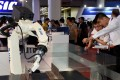 Robots are put through their paces at the China Beijing International High-tech Expo in Beijing in May. Photo: Xinhua