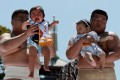 Japanese babies weren't too impressed when amateur sumo wrestlers held them during a baby crying contest at Sensoji temple in Tokyo. Japan's birthrate has again fallen below 1 million for the second year in a row, sparking fresh concerns for the country's population crisis. Photo: Reuters