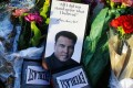 Boxing gloves and a message sit among flowers at a makeshift memorial to Muhammad Ali after he died in 2016 at age 74. President Donald Trump is considering issuing a presidential pardon for Ali, along with some 3,000 others. Photo: AP