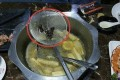 Two women from southern China said they found eight dead cockroaches in their hotpot. Photo: News.163.com