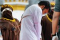 An Indonesian man, one of two to be publicly caned for having sex, is whipped in Banda Aceh. Photo: AFP