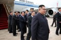 North Korean leader Kim Jong-un steps off an Air China Boeing 747 in Singapore on Sunday. Photo: AFP