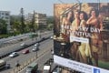 """Indian commuters pass a poster advertising Facebook's """"Live What You Love"""" campaign in Bangalore. Photo: AFP"""