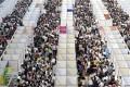 Thousands of job seekers visit booths at a job fair in Chongqing, China. Photo: Reuters