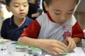 A boy stamps a Chinese character during an exhibition in Taipei. Taiwan, Macau and Hong Kong are the few places where traditional characters are widely used when writing Chinese. Photo: AFP