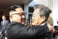 North Korean leader Kim Jong-un and South Korean President Moon Jae-in embrace each other after their meeting at the northern side of the Panmunjom in North Korea on May 26. Photo: AP