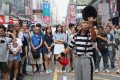 Street performer Andrew So, aka Mr Funny, performs at Sai Yeung Choi Street South in Mong Kok on June 3. Photo: K.Y. Cheng