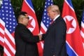 North Korean leader Kim Jong-un shakes hands with US President Donald Trump at the start of their historic summit, at the Capella Hotel on Sentosa island in Singapore, on June 12. Brutal dictators are always happy to be pictured next to world leaders for the same reasons that we should be restrained in granting their requests – such photos grant international legitimacy. Photo: AFP