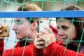 Volunteers take pictures with their mobile phones as they watch the Uruguay national football team traina head of the 2018 World Cup at the Sport Centre Borsky, in Nizhny Novgorod, Russia, on Monday. Photo: Agence France-Presse