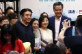Former chief executive Leung Chun-ying (right) posing for photos a the book launch at the Chung Hwa Bookstore in Yau Ma Tei on Tuesday. Photo: Edmond So