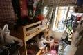 A mother and her child in their subdivided flat home in Sham Shui Po in October 2016. Photo: Edward Wong