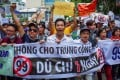 Vietnamese protest in Ho Chi Minh City on Sunday over a proposal to grant companies 99-year land leases in special economic zones. Photo: AFP