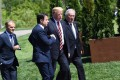 From left, the President of the European Council Donald Tusk, Italian Prime Minister Giuseppe Conte, US President Donald Trump and the President of the European Commission Jean-Claude Juncker arrive for a family photo during the G7 Summit in La Malbaie, Quebec, Canada, on June 8. Photo: Agence France-Presse