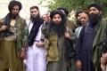 File photo of Mullah Fazlullah (centre) and members of his TTP militant group. Photo: EPA