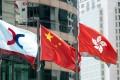 The Hong Kong stock exchange flag (L) flies alongside the flags of China and Hong Kong. Photo: SCMP