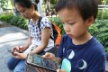 Smartphone addiction is a particular problem when it comes to children, something that both Apple and Google are trying to address with their new features. Photo: Edward Wong