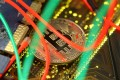 A representation of the Bitcoin virtual currency is seen on a PC motherboard in this file photograph. Photo: Reuters