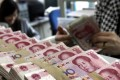 Annual issuance of offshore yuan bonds in Hong Kong have declined by 80.5 per cent from 2014 to 2017. Photo: AP